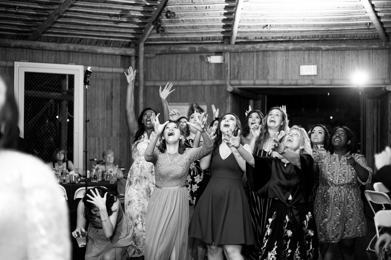 Phoenix zoo wedding, phoenix wedding photographer, arizona destination wedding, wedding in phoenix, intimate wedding inspiration, green wedding, small wedding, Orangutan hut wedding reception, bouquet toss